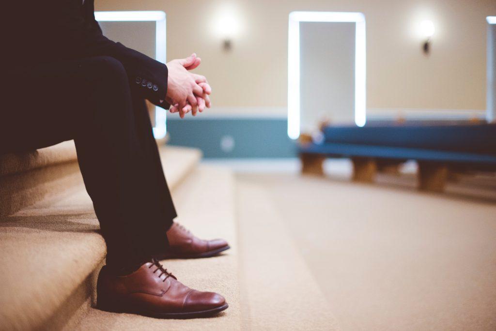 man praying in church, Pray For Your Pastor
